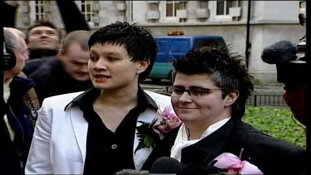 first couple marry under new civil partnership laws; northern ireland: belfast city hall: ext lms lesbian couple, grainne close and shannon sickels,... - heterosexual couple stock videos & royalty-free footage