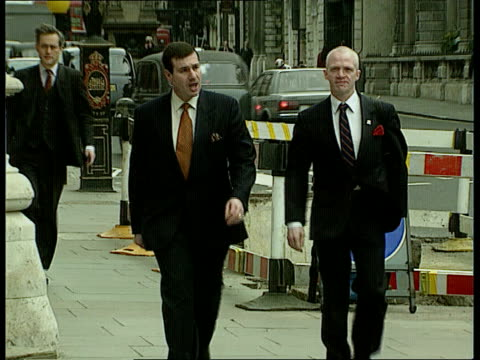 anat england london high court high court tilt down entrance duncan lustigprean and tremane cornish towards pan rl to court - homosexual stock videos & royalty-free footage