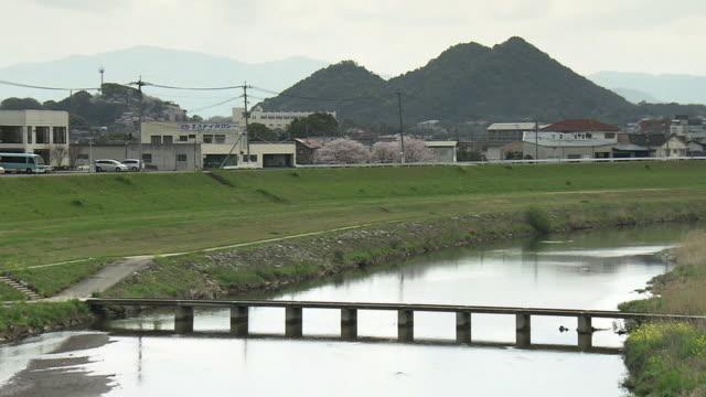 honami river and spoil tip, fukuoka, japan - fukuoka prefecture stock videos and b-roll footage