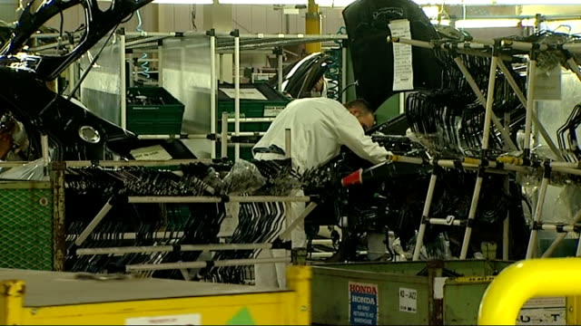 honda factory in swindon: honda car showroom; england: wiltshire: swindon: int various shots of honda cars and workers on factory production line -... - wiltshire stock videos & royalty-free footage