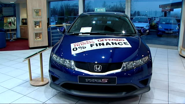 honda car showroom honda crv on display in honda car showroom/ type s on display/ 'sold' sign on car rooftop/ sign on bonnet of honda jazz describing... - honda stock videos & royalty-free footage
