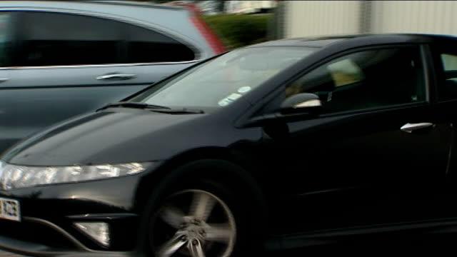 honda formula one team put up for sale; england: northamptonshire: brackley: int jenson button driving car into parking space as hits curb int button... - honda bildbanksvideor och videomaterial från bakom kulisserna