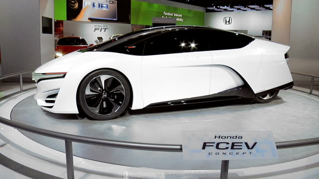 Honda logo on arch TILT DOWNWS car revolving on turntable / CU info sign / MS front end / CU front wheel / CUPAN ACROSS sculptured line along driver...