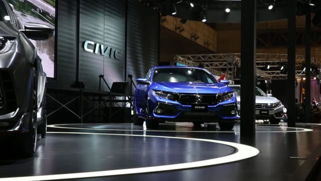 Honda Motor Co Civic hatchback vehicles are displayed at the Tokyo Auto Salon in Chiba Japan on Saturday Jan 14 A customized Toyota Motor Corp Lexus...