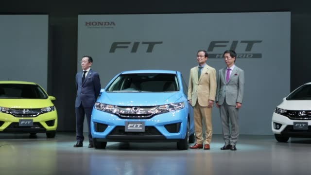 A Honda Motor Co new Fit Hybrid vehicle is unveiled as Takanobu Ito president and chief executive officer of Honda Motor Co gets out of the vehicle...