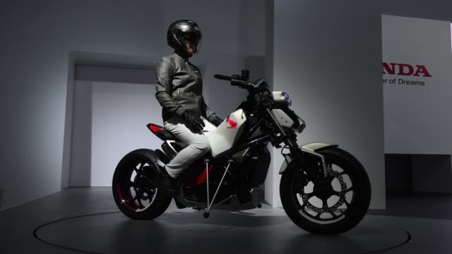 a honda motor co riding assiste concept motorcycle is demonstrated on stage at the tokyo motor show in tokyo japan on thursday oct 26 2017 - honda stock videos & royalty-free footage