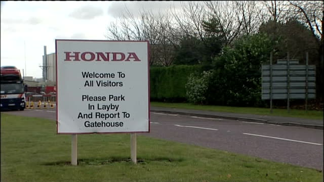 wiltshire swindon ext signs for honda factory truck carrying honda cars along from factory more trucks along from swindon honda sign on side of... - ホンダ点の映像素材/bロール