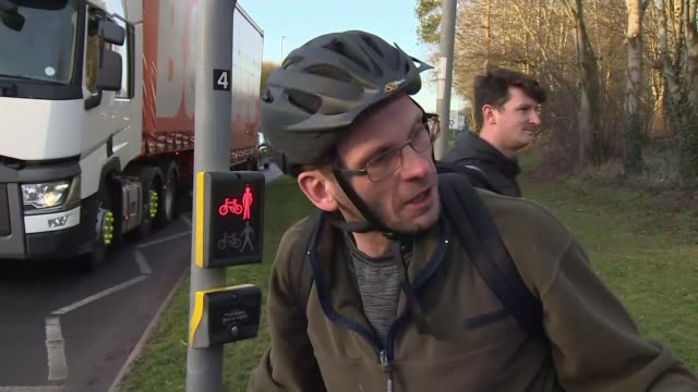 honda to close swindon factory and relocate production to japan england wiltshire swindon cyclists along on bicycles vox pop sot - ホンダ点の映像素材/bロール