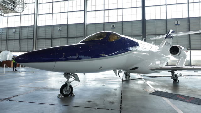a hondajet aircraft manufactured by honda aircraft co stands on display in an ana holdings inc hangar during a news conference in tokyo japan on... - honda stock videos & royalty-free footage