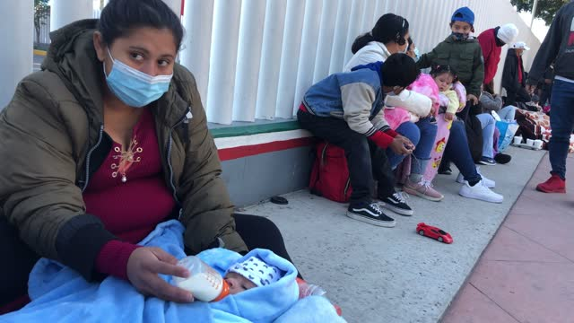 honduran mother sits with her one-month-old son and others who are seeking asylum in the united states outside the el chaparral border crossing on... - border stock videos & royalty-free footage