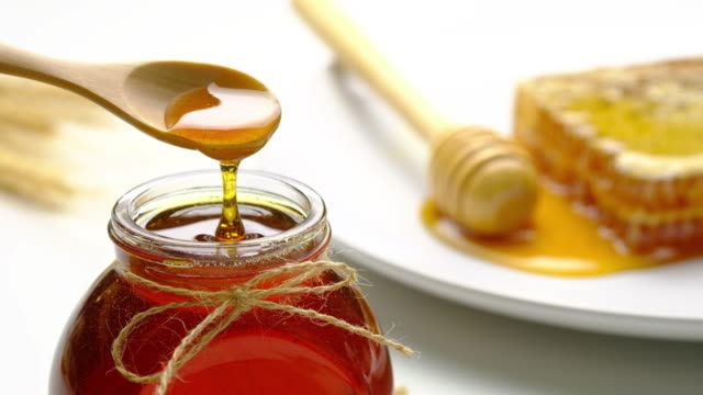 honey and honey comb with wooden stick - thai food stock videos & royalty-free footage