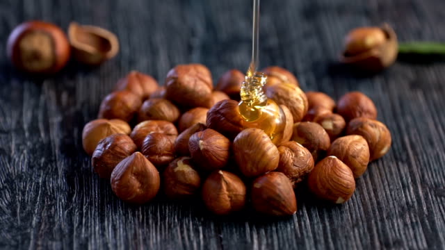 honey and nuts, slow motion. - raw footage stock videos & royalty-free footage