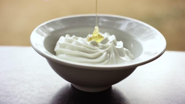 honey being poured on greek yogurt - yoghurt stock videos & royalty-free footage