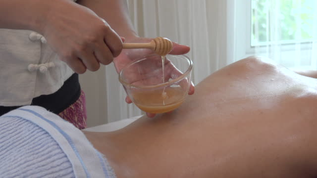honey in spa - massager stock videos and b-roll footage