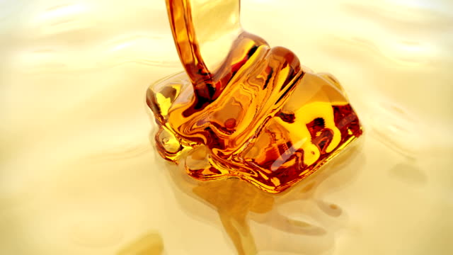 honey pour closeup background - citrus fruit stock videos & royalty-free footage