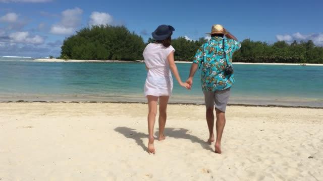 Honeymoon couple enjoys the view and the weather of Muri lagoon in Rarotonga Cook Islands