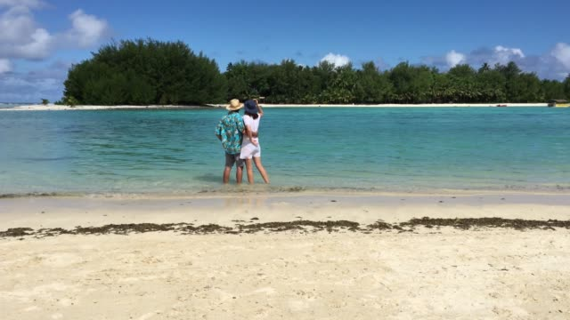 Honeymoon couple enjoys the view and the weather of Muri lagoon in Rarotonga Cook Islands
