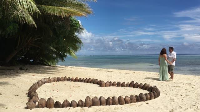 honeymoon couple walks on a tropical pacific island beach - rarotonga stock videos & royalty-free footage