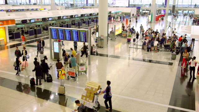 hong kong airport - arrival departure board stock videos and b-roll footage