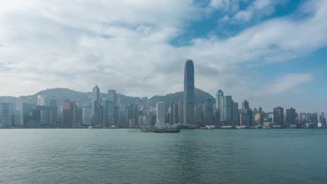 hong kong and passing boats - waterfront stock videos & royalty-free footage
