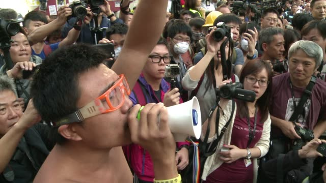 hong kong authorities tear down barricades at a protest site in mongkok the scene of some of the more violent clashes to take place during nearly two... - occupy central stock videos & royalty-free footage