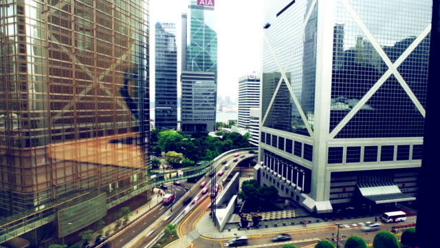 time lapse - hong kong bank central traffic - hsbc main building stock videos and b-roll footage
