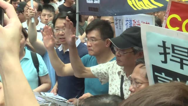 a hong kong bookseller who said he was blindfolded interrogated and detained in china leads a protest march defying beijing as pressure grows for... - bookseller stock videos and b-roll footage