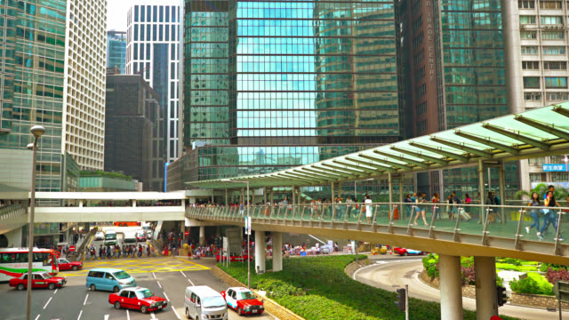 hong kong business district. day. pedestrian. traffic. corporate building - central district hong kong stock videos & royalty-free footage