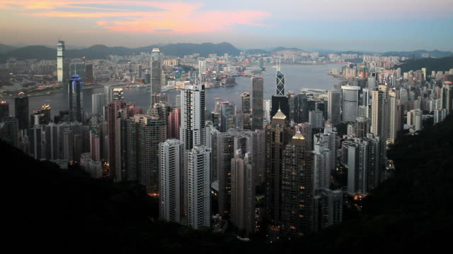 ws ha hong kong business district with bank of china tower, 2 international finance centre and victoria harbor at dusk / china - bank of china tower hong kong stock videos and b-roll footage