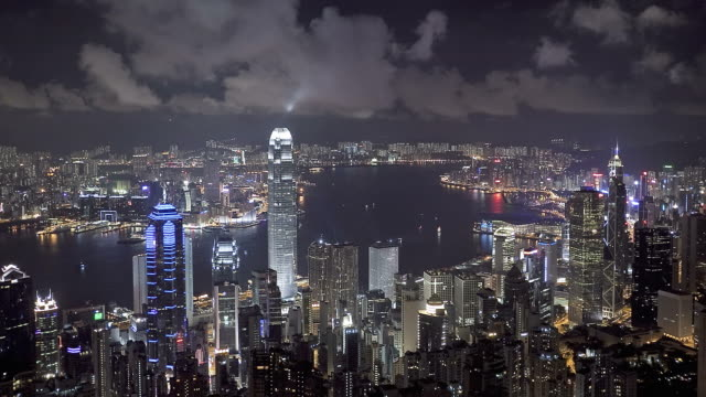 t/l ws ha hong kong business district with bank of china tower, 2 international finance centre and victoria harbor at night / china - bank of china tower hong kong stock videos & royalty-free footage
