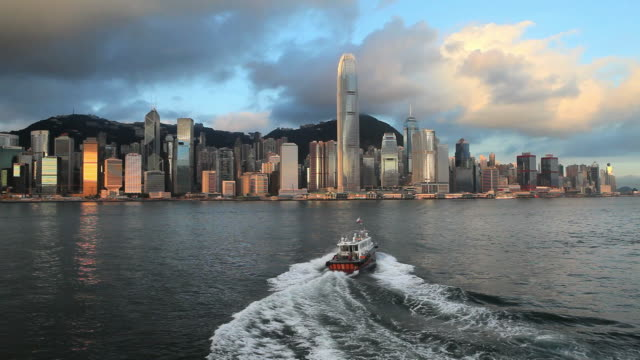ws hong kong business district with bank of china tower and 2 international finance centre seen across victoria harbor with ferry in foreground / china - bank of china tower hong kong stock videos and b-roll footage