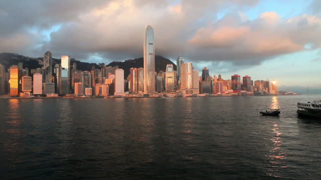 ws pan hong kong business district with bank of china tower and 2 international finance centre seen across victoria harbor at sunset / china - bank of china tower hong kong stock videos and b-roll footage