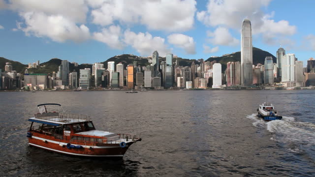 ws hong kong business district with bank of china tower and 2 international finance centre seen across victoria harbor with boats in foreground / china - bank of china tower hong kong stock videos and b-roll footage