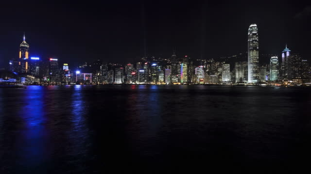 t/l ws hong kong business district with bank of china tower and 2 international finance centre seen across victoria harbor at night / china - bank of china tower hong kong stock videos & royalty-free footage
