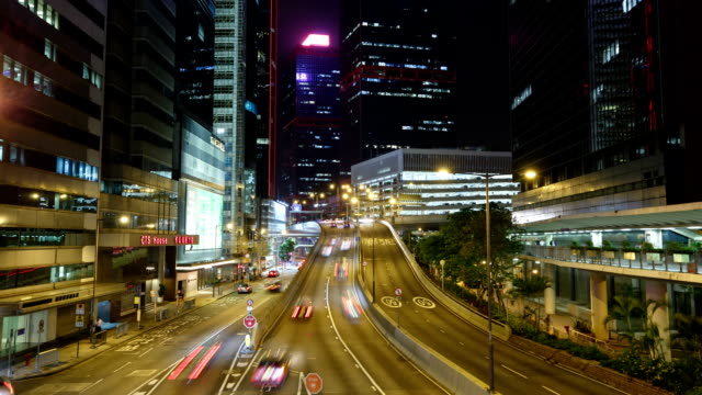 hong kong, car trail on the central highway, night landscape - central district hong kong stock videos & royalty-free footage