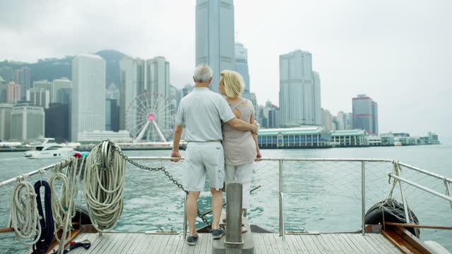 hong kong caucasian seniors city skyscrapers victoria peak - cruising stock-videos und b-roll-filmmaterial