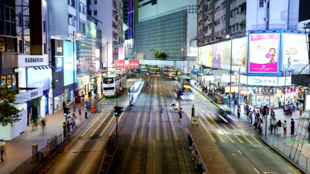 hong kong, causeway bay shopping mall trams and city buildings, night view - wan chai stock videos & royalty-free footage