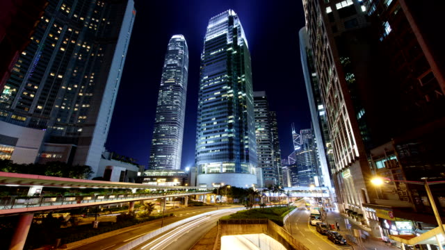 hong kong, central ifc international finance center and the scenery of the road at night - central district hong kong stock videos & royalty-free footage