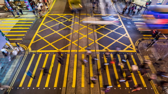 hong kong central pedestrians cross road at night - central district hong kong stock videos & royalty-free footage