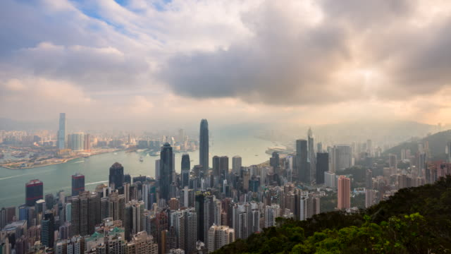 stockvideo's en b-roll-footage met hong kong central skyline and victoria harbour from the peak at sunrise - hongkong