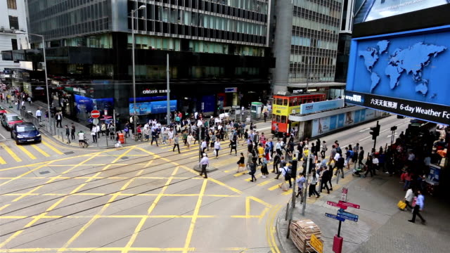 hong kong central traffic and pedestrian crossing - central district hong kong stock videos & royalty-free footage