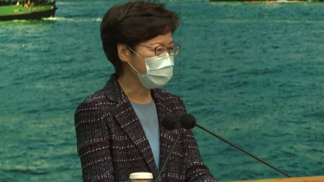 stockvideo's en b-roll-footage met hong kong chief executive carrie lam announces an extension of social distancing measures by 14 days - clean