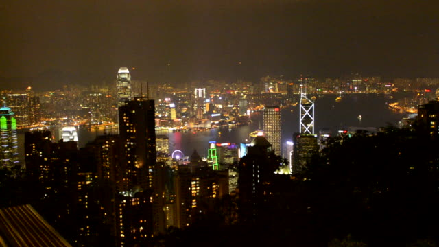 vidéos et rushes de hong kong china skyline harbour night with smog and fog from victoria peak of city skyscrapers haze - victoria peak