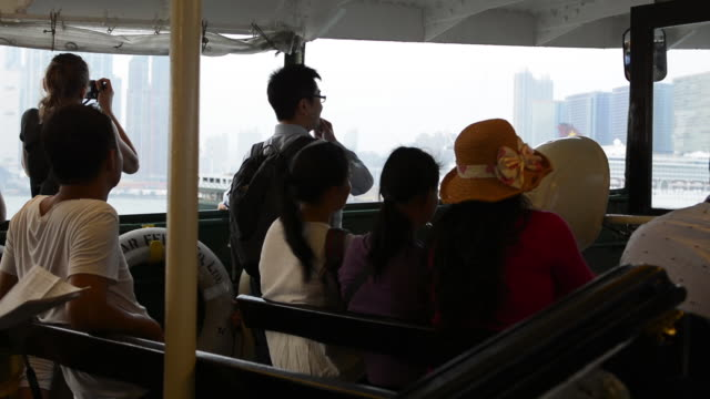 hong kong china star ferry ride across to kowloon with locals passengers commuting - star ferry bildbanksvideor och videomaterial från bakom kulisserna