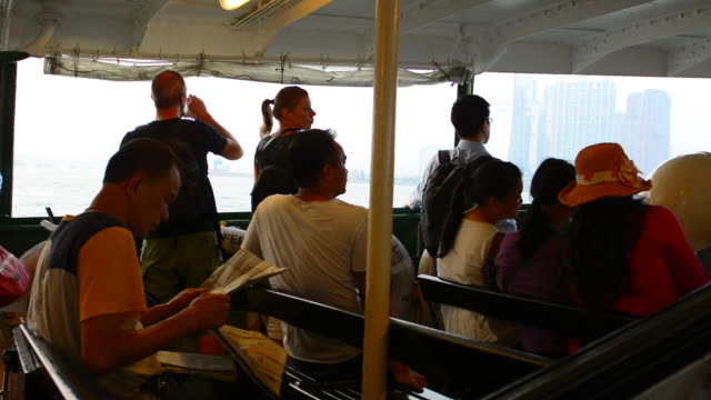 Hong Kong China Star Ferry ride across to Kowloon with locals passengers commuting