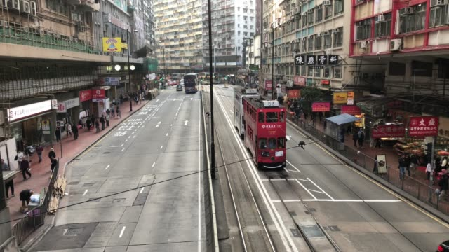 hong kong, china-jan 31,2018: aerial view of the busy traffic and pedestrians in hong kong downtown, china - tram stock videos & royalty-free footage