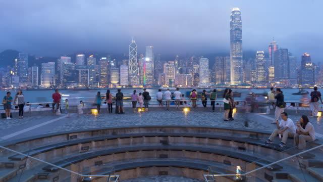 hong kong city skyline looking across victoria harbour to hong kong island at dusk, hong kong, china, asia, time-lapse - hong kong island stock videos & royalty-free footage