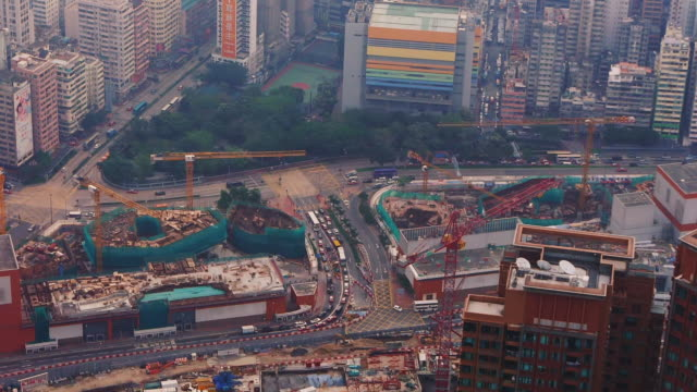 hong kong construction site seen from above - spoonfilm stock-videos und b-roll-filmmaterial