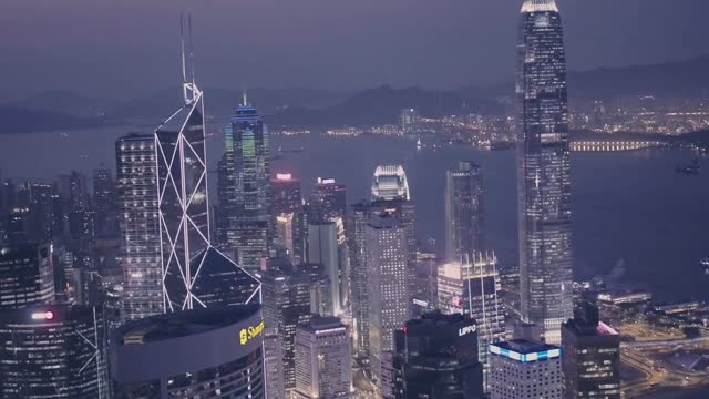stockvideo's en b-roll-footage met hong kong downtown city skyline and international commerce centre (icc) at night. aerial drone view - hong kong