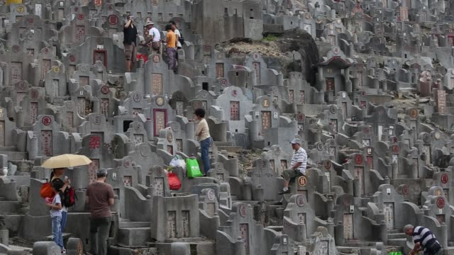 hong kong families trek up to hillside cemeteries to burn offerings for their ancestors with french macaroons proving this year's musthave delicacy... - afterlife stock videos and b-roll footage